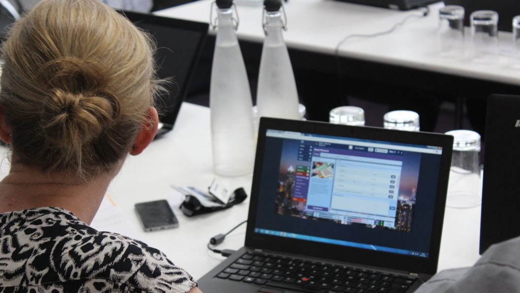 Woman developing business acumen using serious business game